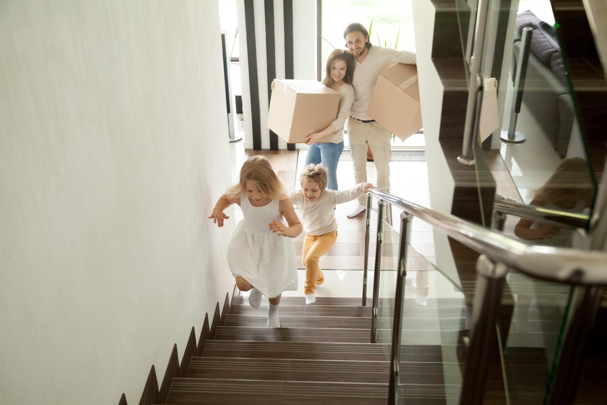 Family with moving boxes in new house